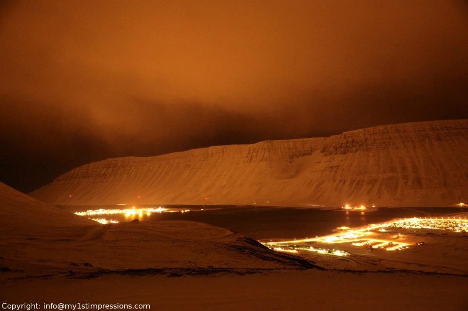 View of Isafjourdur at night, before a snow storm from one of the mountains