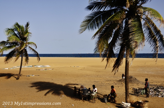 Women selling street food under the palms