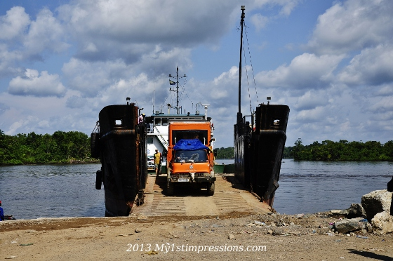 The truck getting off the boat, on the river of Gabon