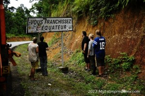 The guys staring at the sign that shows the Equator