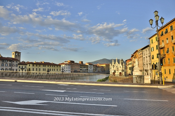 PIsa and the Arno river shining in the setting sun