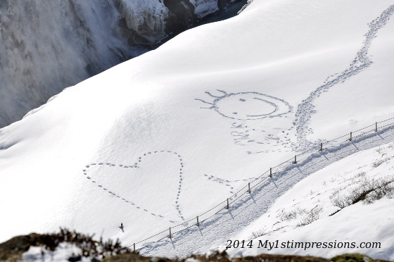 Peace and love drawn on the snow