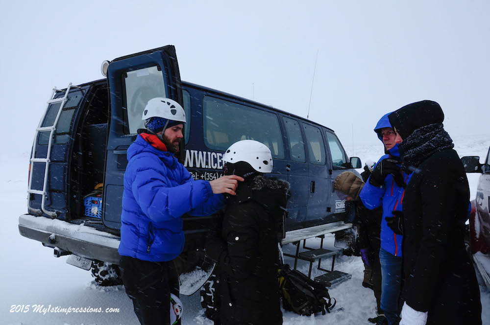 Oskar, iceGuide.is  guide and owner of the company, helps everyone to put the helmet on.
