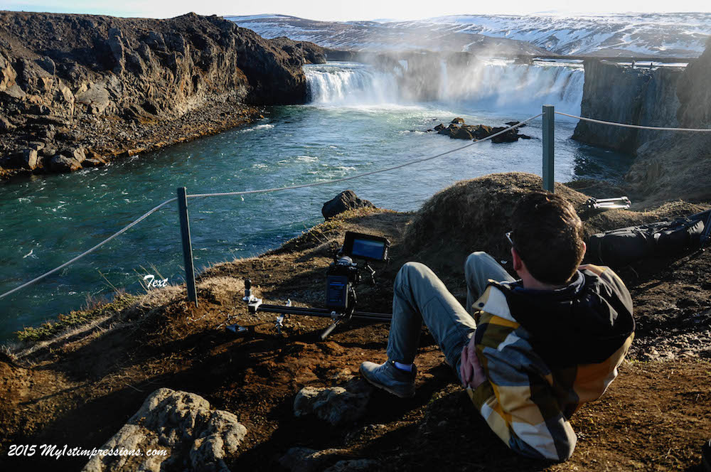 frank enjoying Godafoss' view and the warm sun while filming for Traveltelly